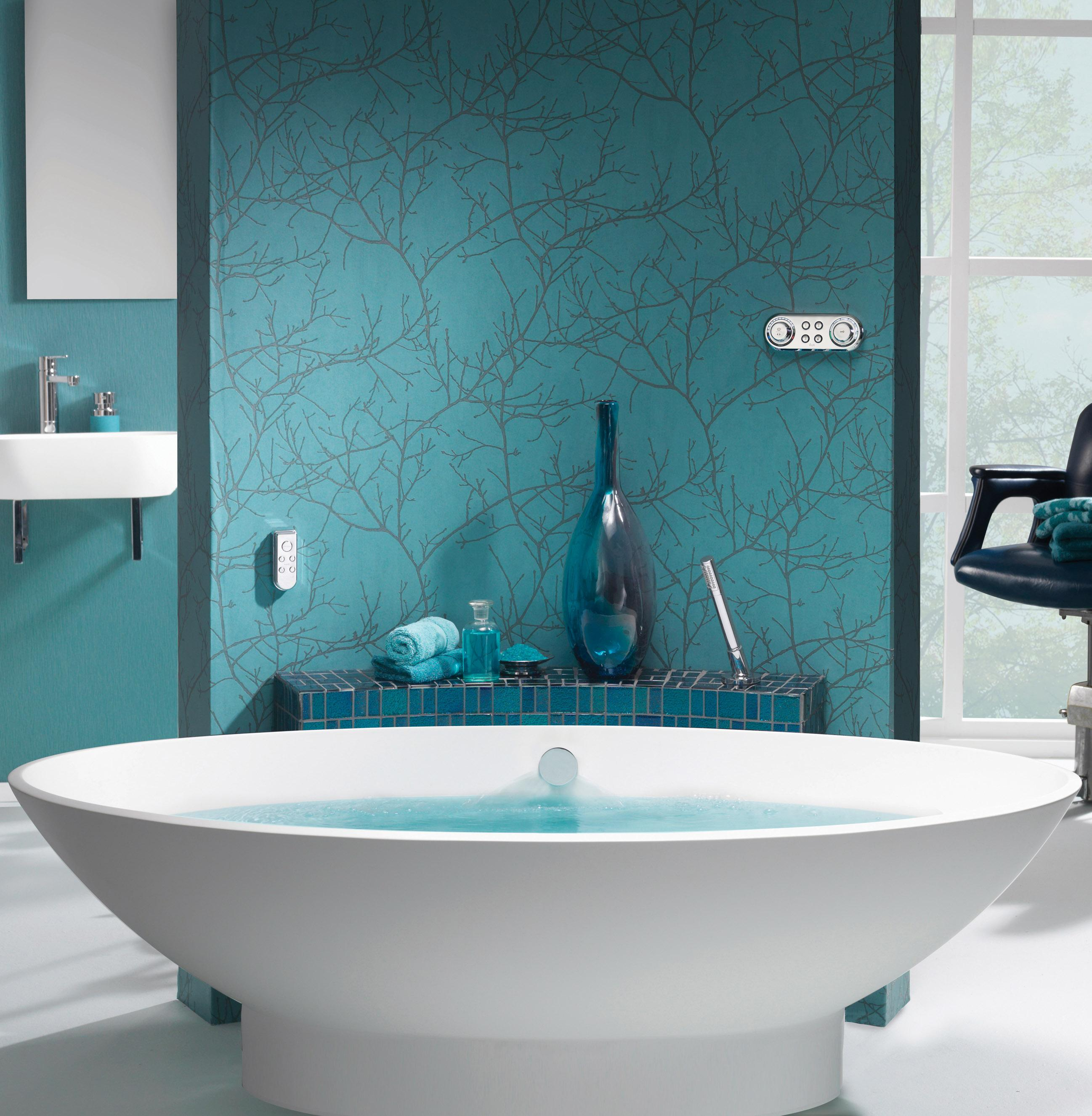 Self standing bath against turqouise wallpaper